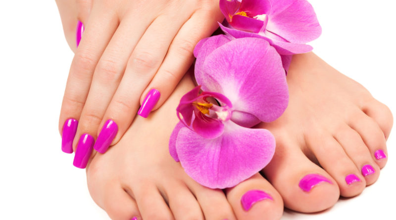 pink manicure and pedicure with a orchid flower. isolated